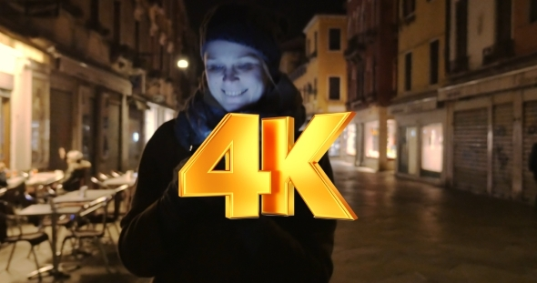 VideoHive Woman Walking At Night And Chatting On Cell Phone 12166112
