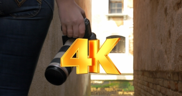 VideoHive Woman With Photo Camera Wandering In Alleyway 12166206