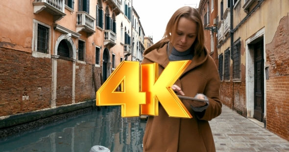 VideoHive Woman Wandering In Venice With Pad 12166237