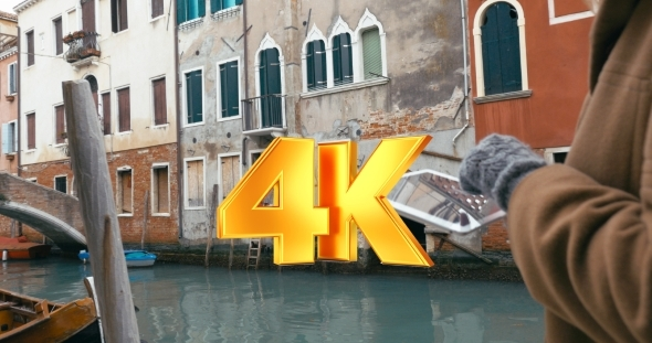 VideoHive Girl Using Tablet PC During The Walk In Venice 12166240
