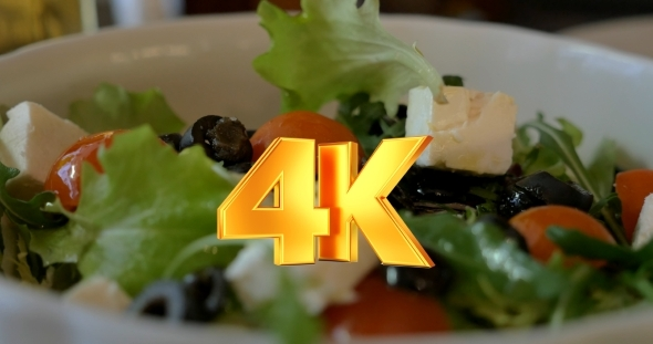 VideoHive Tossing Greek Salad Before Eating 12166243