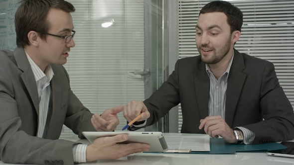 VideoHive Image Of Two Young Businessmen Using Touchpad 12166252