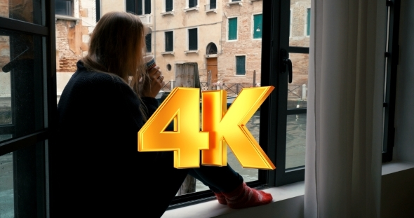 VideoHive Woman Drinking Coffee And Looking At Venice View 12166348