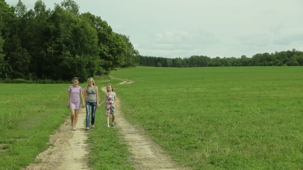 VideoHive Mother And Daughters Walking Holding Their Hands 12168807
