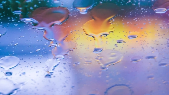 VideoHive Rain Drops Flowing Down On Car Glass During Storm 12170084