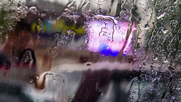 VideoHive Rain Drops Flowing On Car Glass 12170137