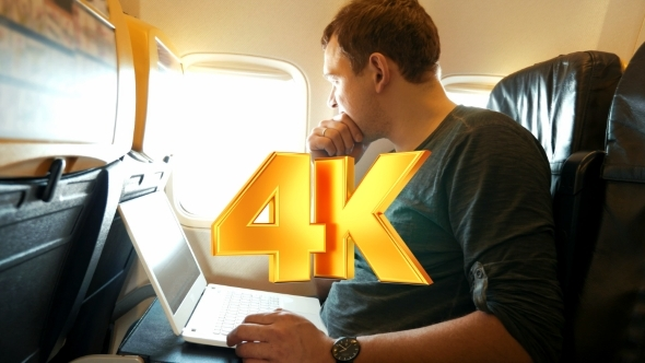 VideoHive Young Man Chatting On Laptop In The Plane 12171919