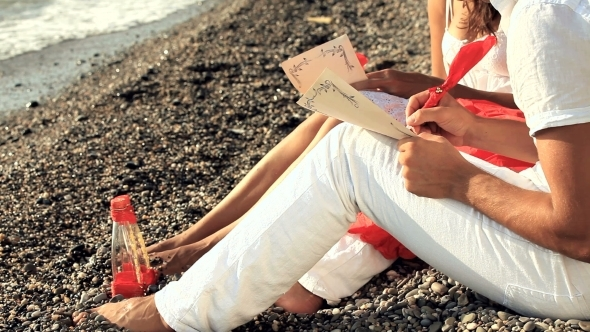 VideoHive Young Couple Writing Romantic Letters On The Beach 12171935