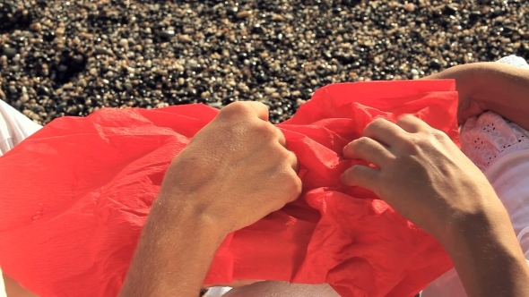 VideoHive Man And Woman Open A Red Bundle 12171946