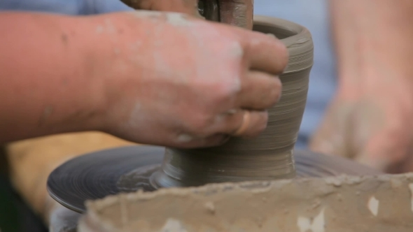 VideoHive Women s Hands Making Ceramic Cup On Potter s Wheel 12172027
