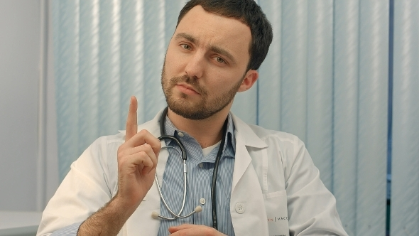 VideoHive Doctor Pointing Above His Head Towards Blank White 12172311