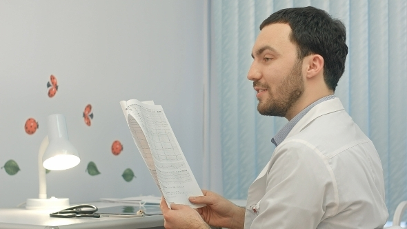 VideoHive Doctor Reading Patient Card At Hospital 12172470