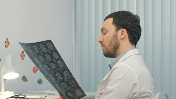 VideoHive Concentrated Male Doctor Looking At X-ray Picture 12172518