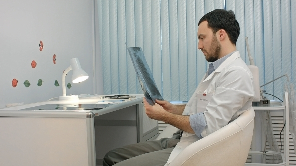 VideoHive Male Doctor Or Dentist Looking At X-ray 12172603