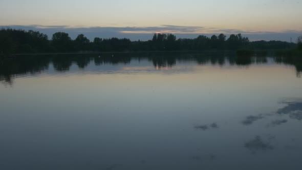 VideoHive Rippling Water Wide Shot Horizon Trees` 12173944