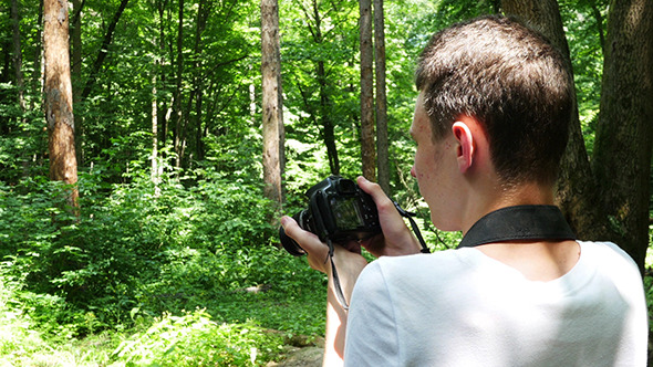 VideoHive Teen In Wilderness Area Taking Picture 12174160