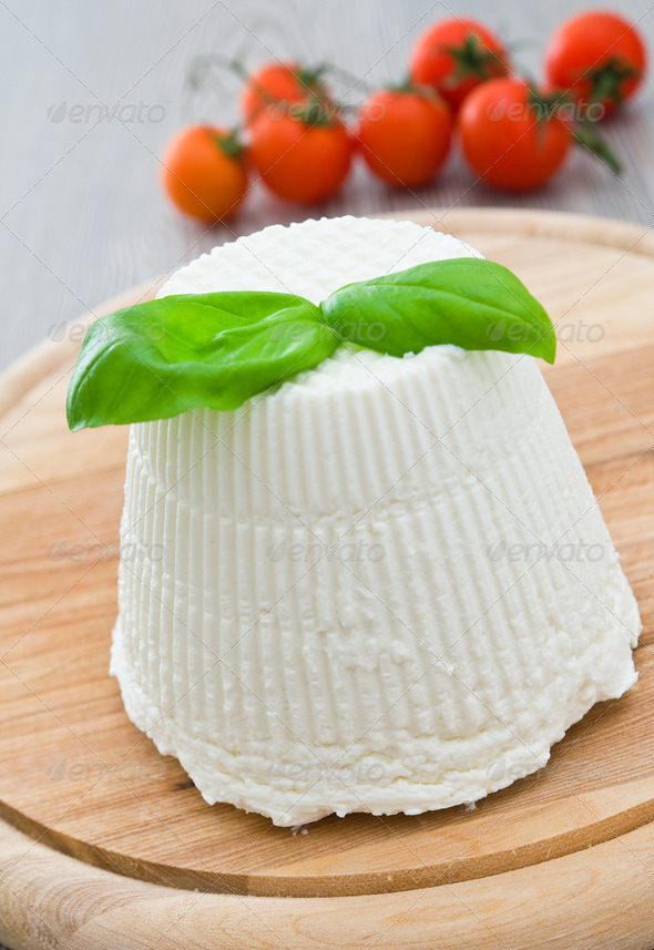Ricotta cheese with basil leaves. - Stock Photo - Images