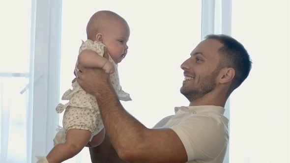 VideoHive Happy Young Father Playing With Little Daughter 12175243