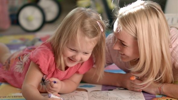 VideoHive Mother And Daughter Writing Together 12175275