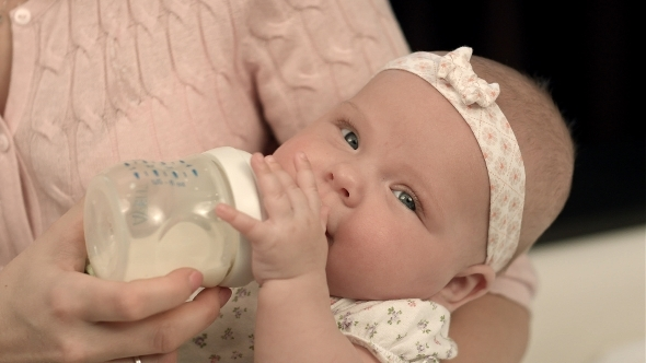 VideoHive Young Mother Is Feeding Her Baby Milk 12175291