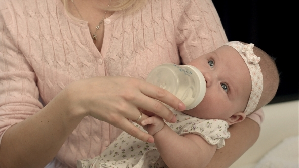 VideoHive Bright Mother Feeding Milk From Bottle Her 12175302