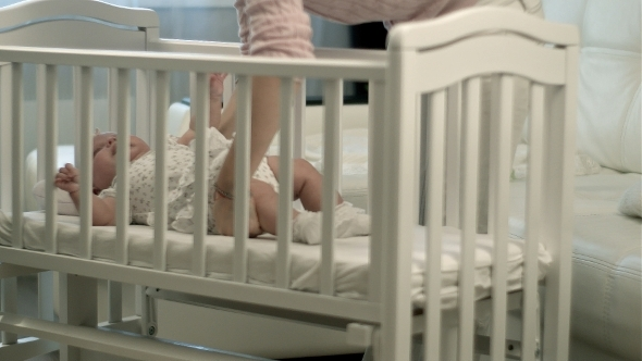 VideoHive Mother Caressing Her Cute Baby Girl Sleeping 12175511