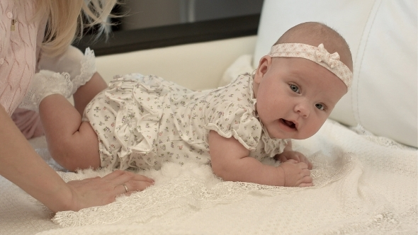 VideoHive Cute 3 Months Baby Lying Down On a Blanket 12175580
