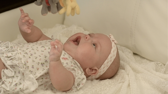 VideoHive Happy Baby Playing With Bed Side Toy Smiling 12175650