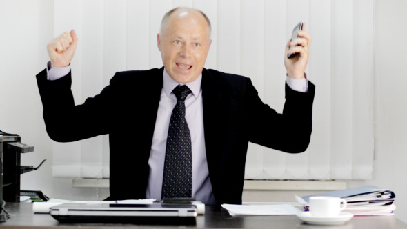 VideoHive Excited Businessman on Phone 12181355