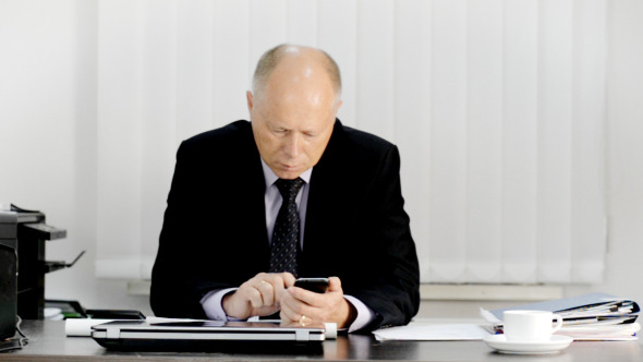 VideoHive Businessman Using Smartphone in Office 12181378