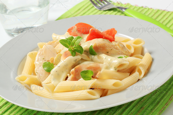 Pasta, chicken meat and cream sauce - Stock Photo - Images