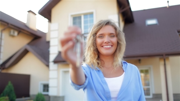 VideoHive Happy Girl With Keys Next To Her New House 12184514