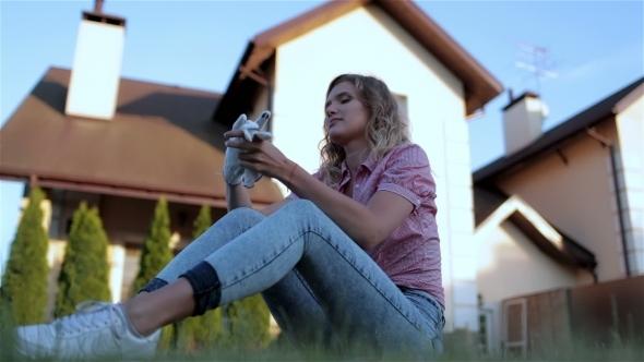 VideoHive Beautiful Girl Sitting In The Yard 12184595