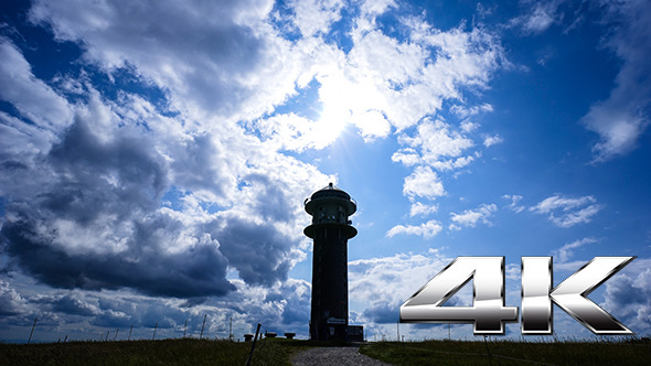 VideoHive Clouds over Tower on a Sunny Day 12186449