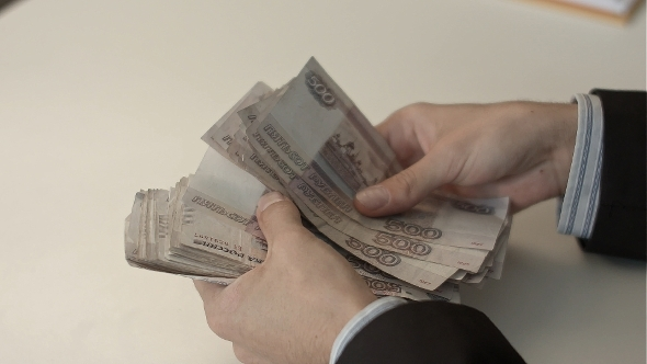 VideoHive Businessman Counts Money In Hands 12186783