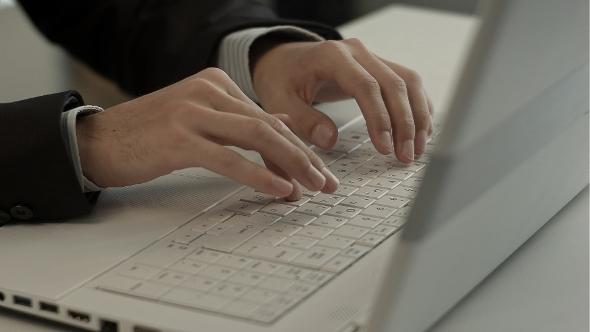 VideoHive Man Typing On Laptop Computer Keyboard 12186827