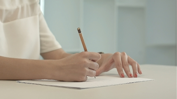 VideoHive Woman With Pencil Writing On Paper 12186893