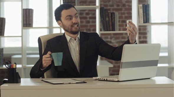 VideoHive Businessman Using Smartphone To Take Picture Of 12187026