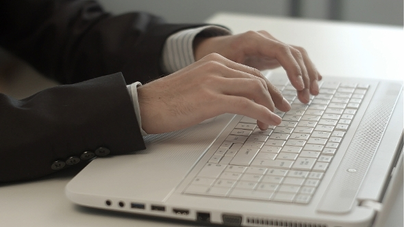 VideoHive Man s Hands Typing On Keyboard Notebook 12187097