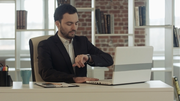 VideoHive Businessman With Notebook In Office Finished Work 12187108
