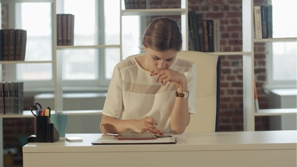 VideoHive Businesswoman In The Office At The Table Working 12187140
