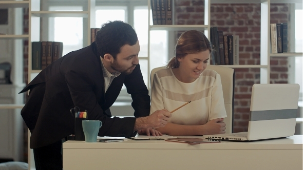 VideoHive Two Business People Discussing Data Or Planning 12187213