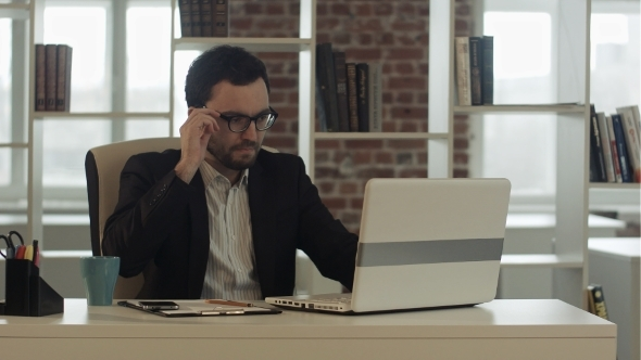 VideoHive Businessman In Funny Glasses Typing On Keyboard 12187551