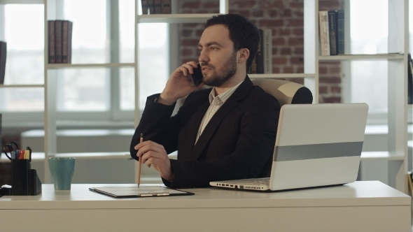 VideoHive Successful Young Business Man Talking On Cell 12187678