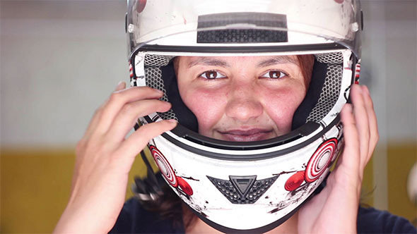 VideoHive Woman Putting on Motorcycle Helmet 12188621