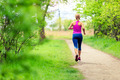Woman jogging in summer park