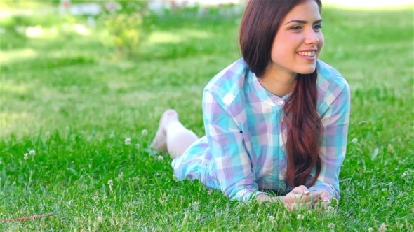 VideoHive Beautiful Smiling Girl Lying On a Grass Outdoor 12190168