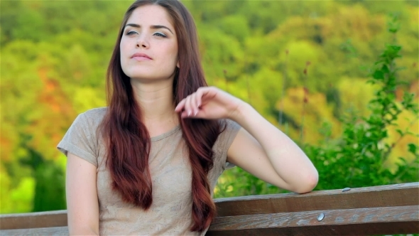 VideoHive Portrait Of a Beautiful Girl Sitting On a Bench 12190177