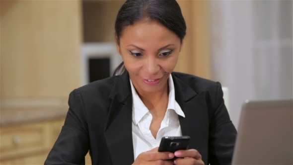 VideoHive Busy Business Woman Texting On Her Cell Phone 12190192