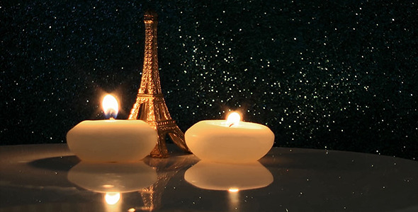 VideoHive Eiffel Tower with Candles on Glittering Background 12190250